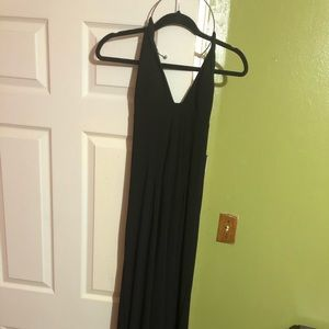 Elegant black dress with silver neck piece